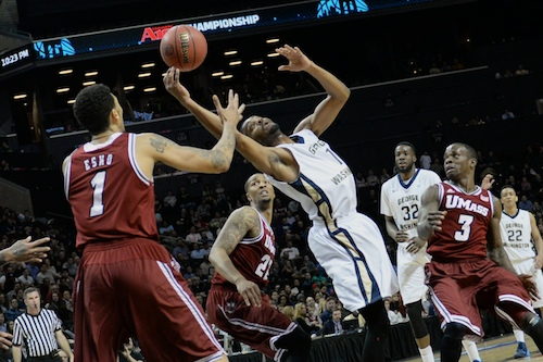Guard Maurice Creek lunges back for the ball in Friday night's win over UMass. Samuel Klein | Photo Editor