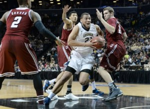 Then-sophomore Kevin Larsen drives past UMass defenders in the Colonials A-10 quarterfinals victory. Hatchet File Photo