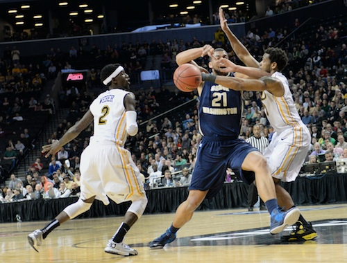 Sophomore forward Kevin Larsen loses the ball against two VCU defenders Satruday. Samuel Klein   Photo Editor