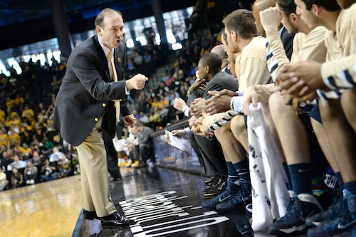 Head coach Mike Lonergan talks to the men's basketball team during the A-10 Tournament last season. Hatchet File Photo
