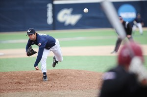 Senior Colin Milon delivers a pitch to a Saint Joseph's batter in GW's 4-3 win Sunday over the Hawks. Cameron Lancaster | Assistant Photo Editor