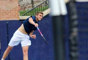 Senior Nikita Fomin hits a serve during GW's 5-2 victory over Georgetown. Zach Montellaro | Hatchet Staff Photographer