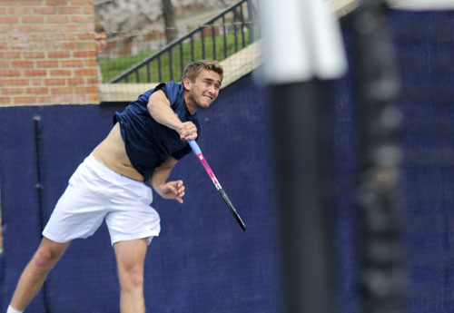 Senior Nikita Fomin hits a serve during GW's 5-2 victory over Georgetown earlier this season. Fomin was named to the A-10 All-Conference First Team. Hatchet File Photo by Zach Montellaro | Hatchet Staff Photographer
