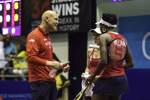 Coach Murphy Jensen talks to players Venus Williams and Martina Hingis. The two former rivals would team up in the women's doubles set, winning 5-2. Zach Montellaro | Hatchet Staff Photographer