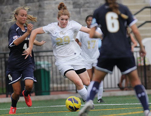 Freshman midfielder Camille Roberts dribbles past defenders during Friday evening's game against Mount St. Mary's. She would go on to score the Colonials' sixth and final goal of the game. Samuel Klein | Senior Photo Editor