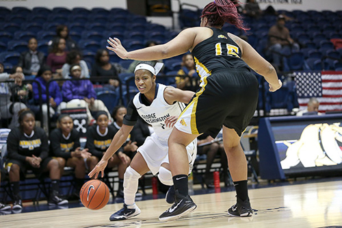 Senior Chakecia Miller drives past a defender in a game earlier this season. Miller tied junior Jonquel Jones for a team-high 14 points in GW's win over Purdue Saturday. File Photo by Dan Rich | Hatchet Photographer
