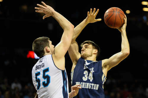 Senior John Kopriva goes up for a shot in the quarterfinals of the Atlantic 10 tournament. Kopriva played his final Atlantic 10 Tournament game as a Colonial Friday in a frustrating loss to Rhode Island. Dan Rich | Hatchet Photographer