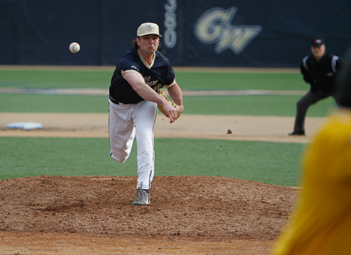 Sophomore Eddie Muhl throws a pitch in a GW win over UMass earlier this season. Muhl broke GW's career saves record with his 18th on Friday. Hatchet File Photo.