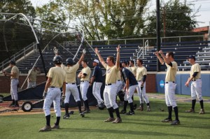 The Colonials celebrate after a home run is hit in batting practice. Dan Rich | Contributing Photo Editor