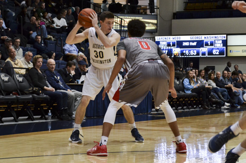 Redshirt junior guard Matt Hart handles the ball in GW's win over Gardner-Webb Tuesday morning. Hart had his second double-digit scoring game in a row, notching 13 points. Camille Ramasastry | Hatchet Photographer