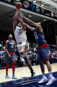 Senior foward Kevin Larsen attempts a layup in GW's 91 to 64 win over Duquesne. Larsen registered 25 points and 11 rebounds in 30 minutes of play. Dan Rich | Contributing Photo Editor