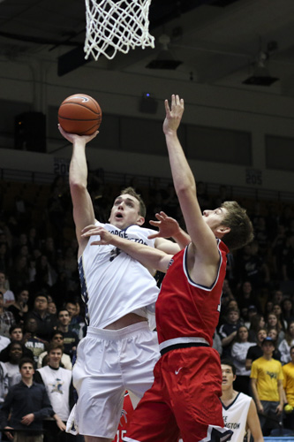 Redshirt junior Tyler Cavanaugh attempts a layup in the Colonials' double-overtime loss to Richmond. With 16 points, Cavanaugh was one of five GW starters to score in double-figures. Jordan McDonald | Hatchet Staff Photographer