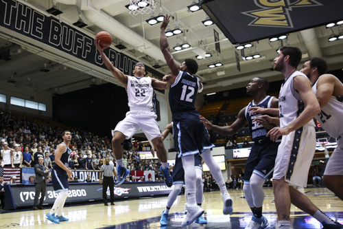 Senior guard Joe McDonald goes up for a layup in the Colonials' 62-58 win over Rhode Island. McDonald had seven points and five rebounds in his first game back from injury. Dan Rich | Contributing Photo Editor