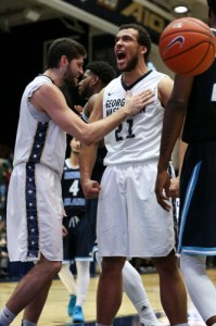 Seniors Patricio Garino and Kevin Larsen celebrate a basket in GW's win over URI. Garino and Larsen combined for 19 points in the win. Dan Rich | Contributing Photo Editor