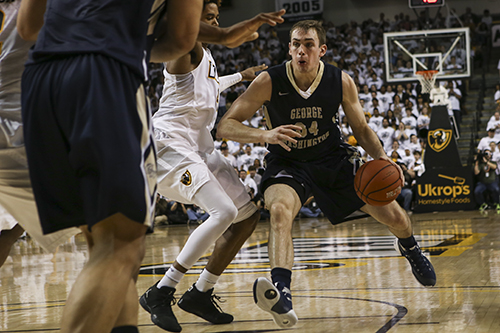 Redshirt junior Tyler Cavanaugh drives to the hoop in the Colonials' win against VCU. Cameron Lancaster | Senior Staff Photographer