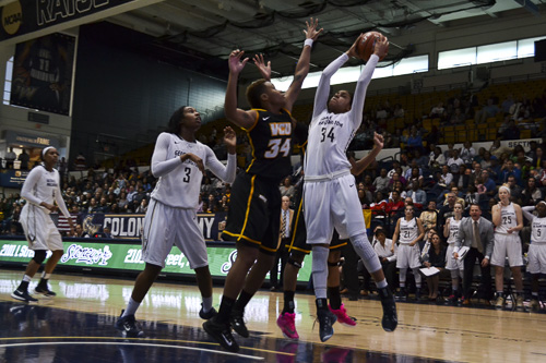 Sophomore Brianna Cummings fights for a basket in GW's loss to VCU on Feb. 20. On Saturday in Richmond, the Colonials exacted revenge over the Rams in a 72–58 A-10 semi-final decision.  Camille Ramasastry | Hatchet Photographer