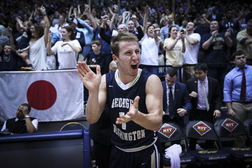 Graduate student guard Alex Mitola celebrates GW's NIT quarterfinal victory over Florida. Mitola scored five in 19 minutes off the bench. Dan Rich | Contributing Photo Editor