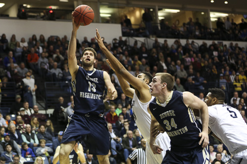 Senior swingman Patricio Garino goes up for a basket in the Colonials' win against Monmouth in the second round of the NIT. Garino scored 19 points in 33 minutes of play. Dan Rich   Contributing Photo Editor