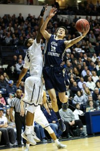 Sophomore forward Yuta Watanabe goes up for a layup in GW's win against Monmouth. Watanabe was held to six points but put up a strong performance on the defensive end. Dan Rich | Contributing Photo Editor