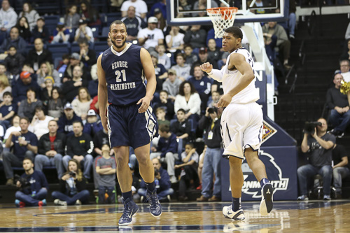 Senior forward Kevin Larsen celebrates a three point basket in the Colonials win over Monmouth in the second round of the NIT. Larsen had 19 points, six of which were from the three ball. Dan Rich | Contributing Photo Editor