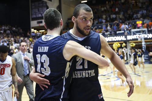 Seniors Patricio Garino and Kevin Larsen hug after GW's win over Florida on March 23. Garino and Larsen will participate in the Portsmouth Invitational tournament this weekend. Dan Rich | Contributing Photo Editor