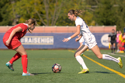 Senior MacKenzie Cowley dribbles the ball around a Richmond defender during the women's soccer game on Sunday. Cowley scored her team-high ninth goal of the season against the Spiders. Sam Hardgrove | Assistant Photo Editor