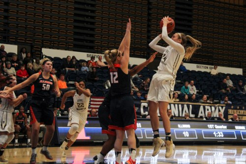 Graduate student Lexi Martins goes up for a shot in GW's win over Illinois. Jack Borowiak | Hatchet Photographer
