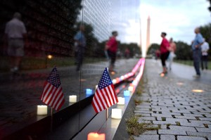 Marking 13th anniversary of the September 11th attacks, a lone US flag stands along side a row of red, white, and blue lights placed by the Vietnam Veterans Memorial Fund.  Samuel Hardgrove | Hatchet Staff Photographer