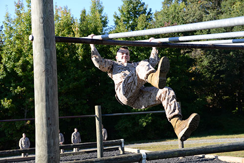 Before entering the NROTC program, midshipmen choose between the Navy or the Marines. Sophomore Andrew Bell, navigating an obstacle course, is one of 36 students training to become an officer in the Marine Corps.