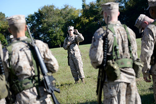 The Marine Option midshipmen learn basic fire team movement and how to communicate using hand signals during small-unit leadership exercises. Senior Casey LaMar instructed younger midshipmen on how to lead their fire teams while on patrol.