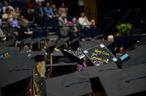 "A member of the graduating class from the Graduate School of Education and Human Development wears a cap that reads ""Keep Calm and Counsel on!"" Katie Causey 