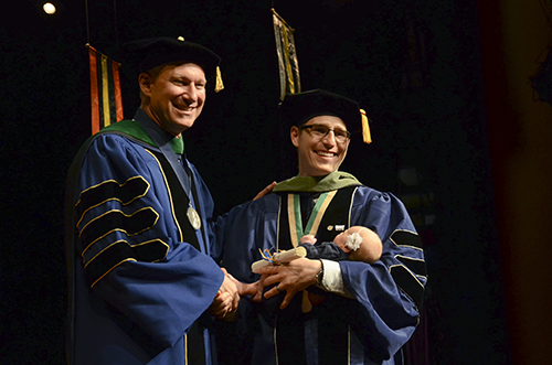 Jeffrey Chase Farnsworth received a doctoral degree in physical therapy at the School of Medicine and Health Sciences Graduation Celebration on Saturday. Katie Causey | Photo Editor