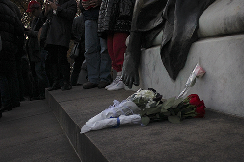 While some attendees held signs of support others carried red, white, and blue flower – the colors of the French tricolor – which they laid at the base of the Statue of the Marquis de Lafayette. Marquis de Lafayette, a French aristocrat and officer who fought in the Revolutionary War, is often viewed as a symbol of strength between the alliance of France and the United States. Paige James   Hatchet Photographer
