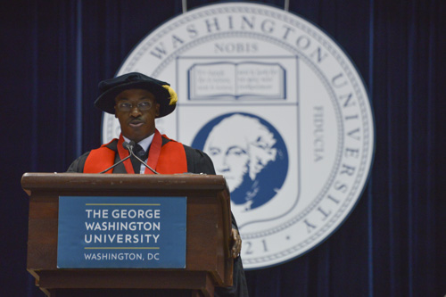 Reuben Brigety, the dean of the Elliott School of International Affairs, makes remarks during the school's graduation ceremony. Ashley Le   Hatchet Photographer