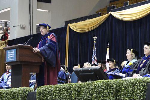 Michael Feuer, the dean of the Graduate School of Education and Human Development, addresses graduates. Blair Guild | Hatchet Staff Photographer