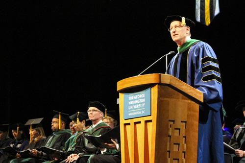 Dean Jeffrey Akman addresses graduates at the School of Medicine and Health Sciences celebration Sunday. Jake Amorelli | Staff Photographer