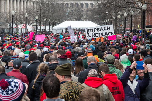 Protestors blocked the entrance to a checkpoint to the inauguration ceremony Friday morning. Mike Shanahan | Hatchet Photographer