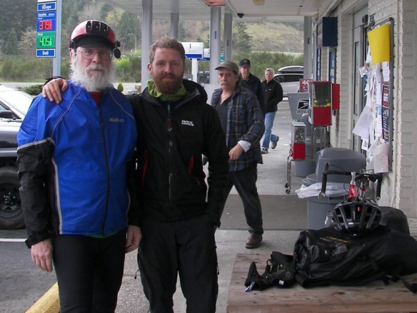 Riding to Olympia with our first Warm Showers guest of the season, Andreas. (at Island Market, halfway)