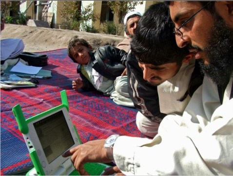 Afghan family browsing Wikipedia together outside