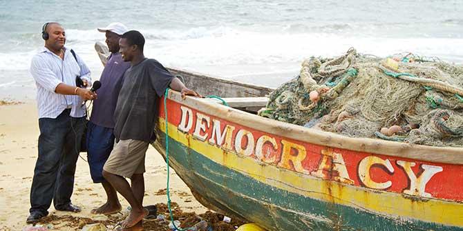 BBC Media Action producer Hassan Arouni (left) interviews contributors in Sierra Leone. Copyright, BBC Media Action.
