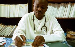 A doctor at work in Ivory Coast, but many of his colleagues are choosing to pursue careers abroad Credit: The World Bank via Flickr (http://bit.ly/1ke9QbW)  CC BY-NC-ND 2.0