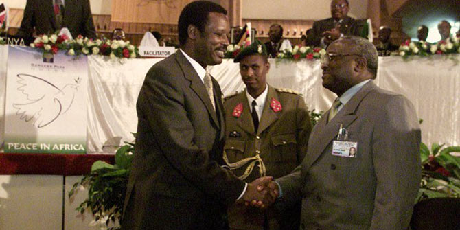 President of Burundi, Pierre Buyoya, left, shakes hands with Front for Democracy in Burundi (FRODEBU) Secretary General Domitien Ndayizeye at the conclusion of the 15th Burundi peace summit in Arusha, Tanzania, Monday July 23, 2001. (AP Photo/Jean-Marc Bouju)