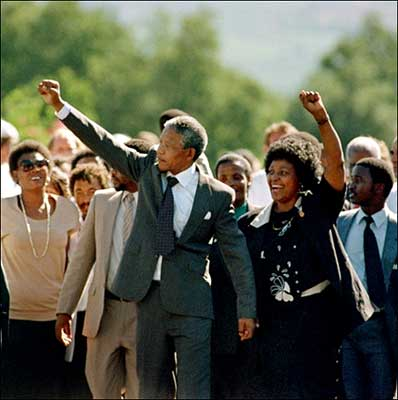 Mandela walks free from prison on 11 February 1990