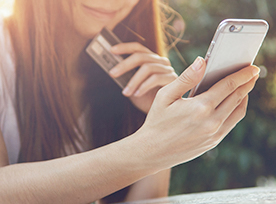 Woman online shopping from mobile phone