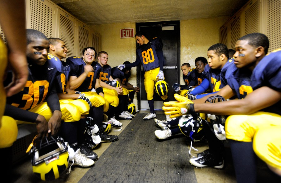 ADAM GERIK/JOURNAL STAR  The Woodruff Warriors crowd together anxiously in the tiny locker room of Peoria Stadium on Friday night as the clock counts down to their season's kickoff.
