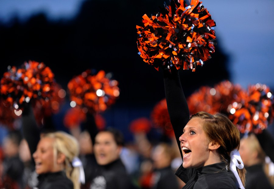RON JOHNSON/JOURNAL STAR   Washington cheerleader Kaley Caldwell, right, and teammates cheer on the Panthers Friday night.