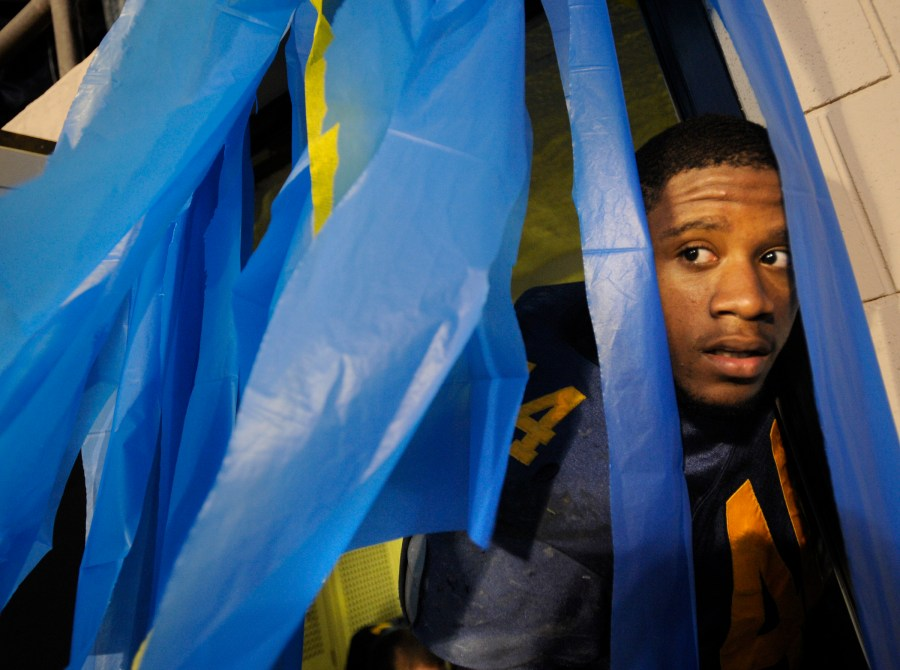 RON JOHNSON/JOURNAL STAR   Woodruff High School senior Keith Jones, takes a lasting look at the crowd outside the Peoria Stadium locker room before he takes the field on the team's last home game of the school's existance Friday night. Woodruff won their homecoming game 35-0 over Peoria High.