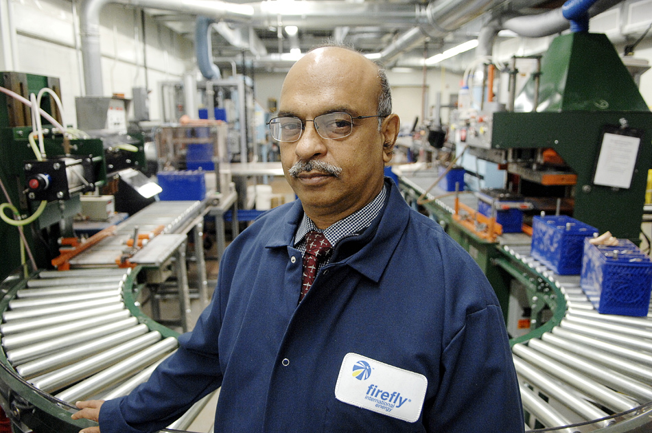 NICK SCHNELLE/JOURNAL STAR  Mukesh Bhandari, owner of Firefly International Energy, which manufactures batteries.
