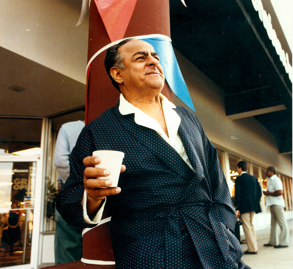 In this 1985 Journal Star file photo, Mayor Jim Maloof serenades shoppers in his robe and slippers at a Peoria store's grand opening.