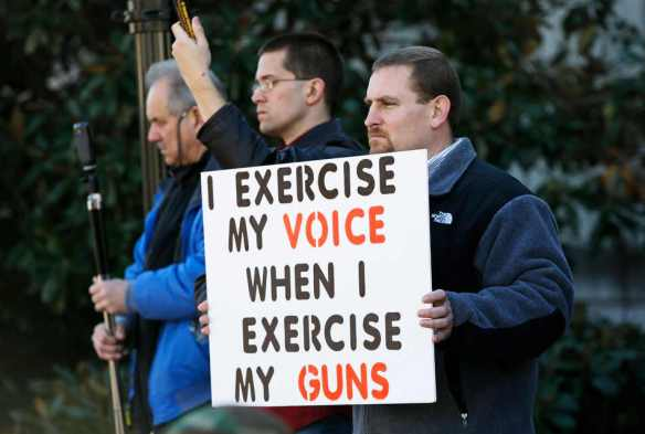 "Matt Givens, of Spring Hill, Tenn., right, attends a gun rights rally on Saturday, Jan. 19, 2013, in Nashville, Tenn. Supporters of gun rights held ""Guns Across America"" rallies across the country Saturday in response to President Barack Obama's plan to curb gun violence. (AP Photo/Mark Humphrey)"